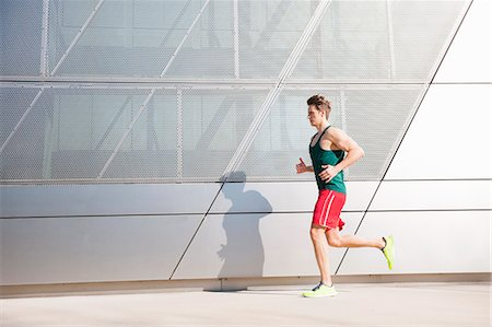runner (male) - Mid adult man running in city Stock Photo - Premium Royalty-Free, Code: 649-07585379