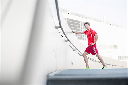 runner (male) - Mid adult man stretching before run Stock Photo - Premium Royalty-Free, Code: 649-07585386