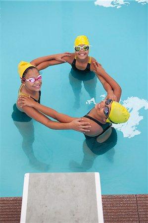 sports - Portrait of three schoolgirl swimmers making circle Stock Photo - Premium Royalty-Free, Code: 649-07585406