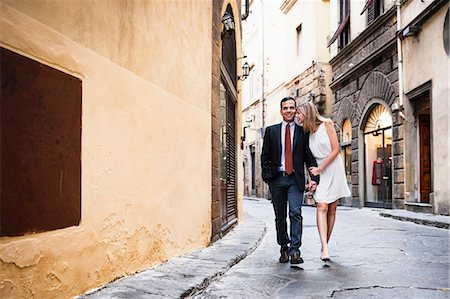 europe - Couple holding hands, walking down street in Florence Stock Photo - Premium Royalty-Free, Code: 649-07585401