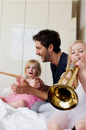 dress up girl - Father and two young daughters playing music Stock Photo - Premium Royalty-Free, Code: 649-07585447