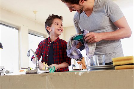 Father and son doing washing up Stock Photo - Premium Royalty-Free, Code: 649-07585451
