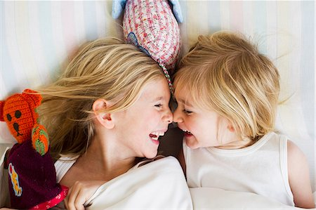 sister - Portrait of two young sisters lying face to face in bed Stock Photo - Premium Royalty-Free, Code: 649-07585466