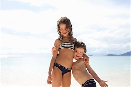 sister - Brother and sister standing on beach in Seychelles Stock Photo - Premium Royalty-Free, Code: 649-07585547