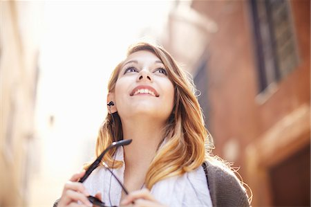 Young woman looking up at buildings, Rome, Italy Stock Photo - Premium Royalty-Free, Code: 649-07585567