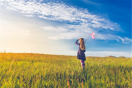 Girl carrying butterfly net in spring meadows, Reykjavic, Iceland Stock Photo - Premium Royalty-Free, Code: 649-07585585