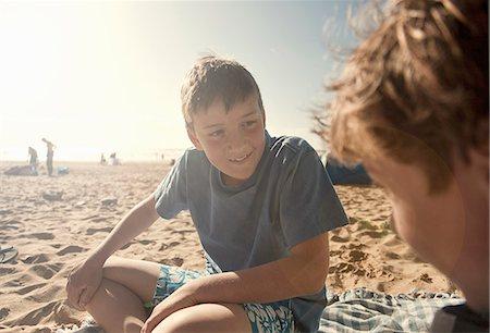 preteen beach - Boys sitting on beach Stock Photo - Premium Royalty-Free, Code: 649-07585655
