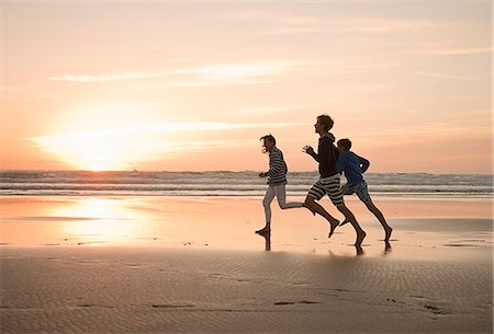 family active beach - Mother and sons running on beach Stock Photo - Premium Royalty-Free, Code: 649-07585658