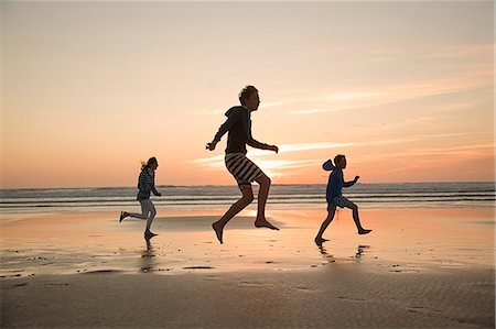 Mother and sons running on beach Stock Photo - Premium Royalty-Free, Code: 649-07585659