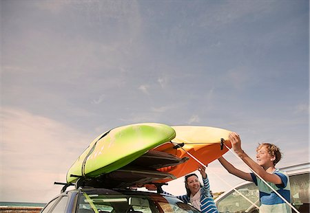 road trip - Mother and son stacking kayaks on top of car Stock Photo - Premium Royalty-Free, Code: 649-07585669