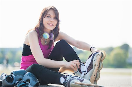 roller skate - Young woman putting on rollerblades Stock Photo - Premium Royalty-Free, Code: 649-07585675