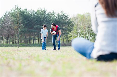 preteen boys playing - Boy practicing rugby with parents in park Stock Photo - Premium Royalty-Free, Code: 649-07585715