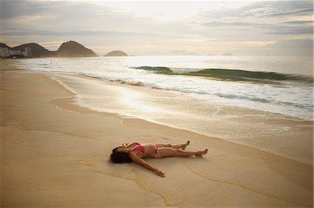 Mature woman sunbathing on Copacabana beach at sunset, Rio De Janeiro, Brazil Stock Photo - Premium Royalty-Free, Code: 649-07585727
