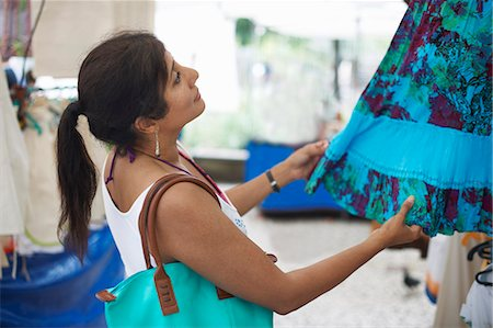 south american woman - Mature woman looking at skirt on market stall, Ipanema, Rio De Janeiro, Brazil Stock Photo - Premium Royalty-Free, Code: 649-07585734