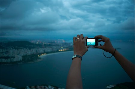 south american woman - Close up of female hands photographing view of Rio De Janeiro at night, Brazil Stock Photo - Premium Royalty-Free, Code: 649-07585767