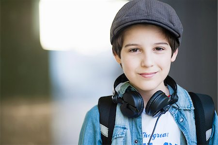 preteen  smile  one  alone - Portrait of boy wearing flat cap, close up Stock Photo - Premium Royalty-Free, Code: 649-07585805
