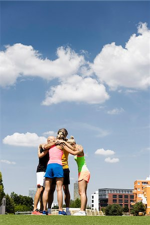 four - Exercise group huddled together in park Stock Photo - Premium Royalty-Free, Code: 649-07596108