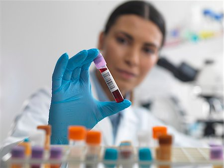 Doctor preparing to view blood sample under microscope in laboratory for medical testing Stock Photo - Premium Royalty-Free, Code: 649-07596124