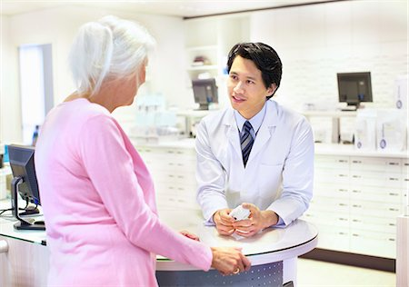 Male pharmacist advising customer on medication Stock Photo - Premium Royalty-Free, Code: 649-07596148