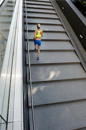 Jogger running up steps Stock Photo - Premium Royalty-Free, Code: 649-07596161
