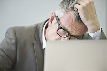 person overwhelmed stresss - Stressed mature businessman in office Stock Photo - Premium Royalty-Free, Code: 649-07596246