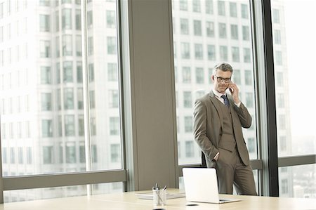 Portrait of businessman in high rise office Stock Photo - Premium Royalty-Free, Code: 649-07596255