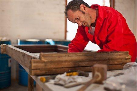 Carpenter working on wooden frame Stock Photo - Premium Royalty-Free, Code: 649-07596289