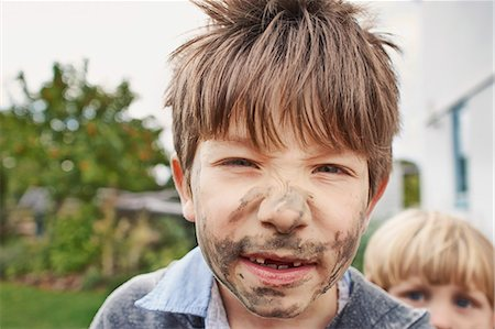 dirty - Boy with muddy face Stock Photo - Premium Royalty-Free, Code: 649-07596304