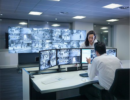 security - Security guards working at CCTV screens in control room Stock Photo - Premium Royalty-Free, Code: 649-07596326