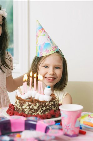 Portrait of young girl enjoying her birthday party Stock Photo - Premium Royalty-Free, Code: 649-07596358