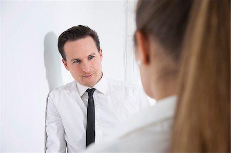 Office workers flirting in office corridor Stock Photo - Premium Royalty-Free, Code: 649-07596350