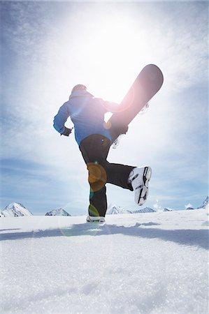 Mature man carrying his snowboard uphill, Obergurgl, Austria Stock Photo - Premium Royalty-Free, Code: 649-07596377