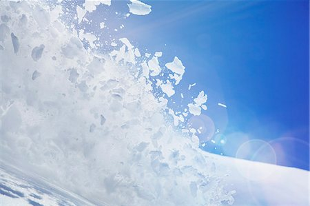 exploding - Close up of snow covered hill with powder snow and ice mid air Stock Photo - Premium Royalty-Free, Code: 649-07596371