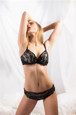 Young woman wearing black lingerie Stock Photo - Premium Royalty-Free, Code: 649-07596416