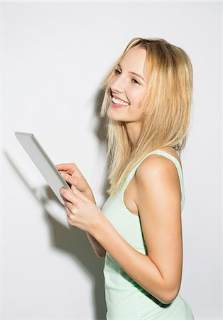 Young woman using digital tablet Stock Photo - Premium Royalty-Free, Code: 649-07596413