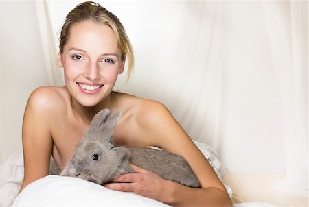 Young woman holding rabbit Stock Photo - Premium Royalty-Free, Code: 649-07596443