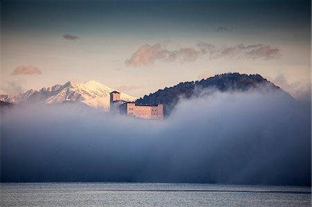 scenic view - Mist and Castello di Angera, Lake Maggiore, Italy Stock Photo - Premium Royalty-Free, Code: 649-07596472