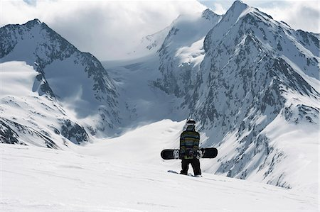 sports and snowboarding - Young male snowboarder walking up mountain, Obergurgl, Austria Stock Photo - Premium Royalty-Free, Code: 649-07596486