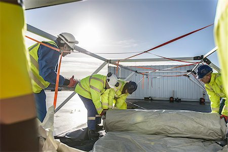 Emergency Response Team workers erecting tent control centre Stock Photo - Premium Royalty-Free, Code: 649-07596617