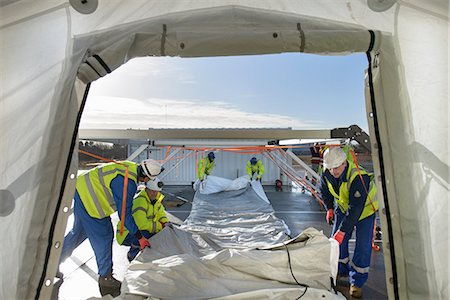 Emergency Response Team workers erecting tent control centre Stock Photo - Premium Royalty-Free, Code: 649-07596618