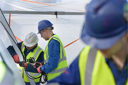 Emergency Response Team workers erecting tent control centre Stock Photo - Premium Royalty-Free, Code: 649-07596622