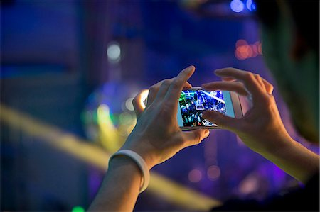 Man taking photograph in nightclub with cellular phone Stock Photo - Premium Royalty-Free, Code: 649-07596631