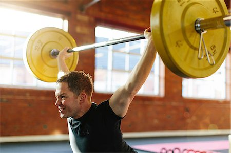 Man lifting weights in gymnasium Stock Photo - Premium Royalty-Free, Code: 649-07596659