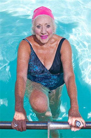 Portrait of happy senior woman in swimming pool Stock Photo - Premium Royalty-Free, Code: 649-07596670