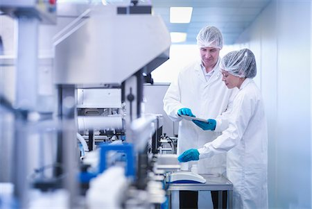 people working in factory - Workers inspecting product in pharmaceutical factory Stock Photo - Premium Royalty-Free, Code: 649-07596684