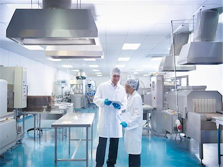 pharmaceutical plant - Workers in discussion in pharmaceutical factory Stock Photo - Premium Royalty-Free, Code: 649-07596685