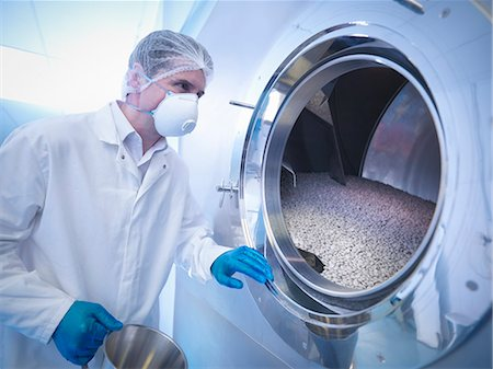 pharmaceutical plant - Worker using tablet coating machine in pharmaceutical factory Stock Photo - Premium Royalty-Free, Code: 649-07596695