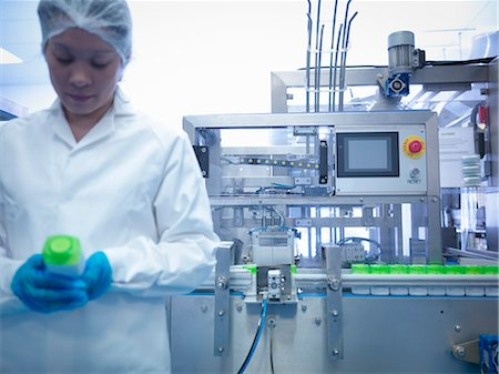 pharmaceutical plant - Worker inspecting products on production line in pharmaceutical factory Stock Photo - Premium Royalty-Free, Code: 649-07596690