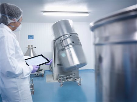pharmaceutical plant - Worker holding digital tablet and watching ingredient mixing machine in pharmaceutical factory Stock Photo - Premium Royalty-Free, Code: 649-07596704