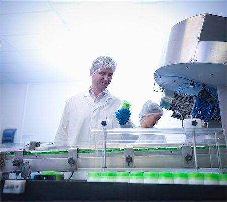 science & technology - Workers inspecting products on production line in pharmaceutical factory Stock Photo - Premium Royalty-Free, Code: 649-07596709